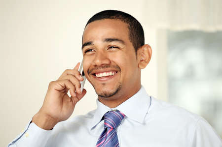 Laughing man on mobile phone Stock Photo - 9336834