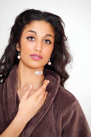 Beautiful woman applying moisturizing cream on neck Stock Photo - 9400538
