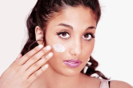 Pretty girl applying face cream Stock Photo - 9400537