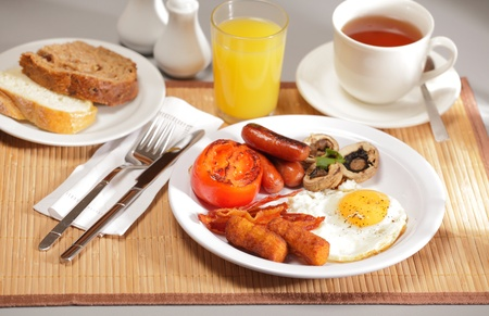 Delicious breakfast on table setting Stock Photo - 9400539