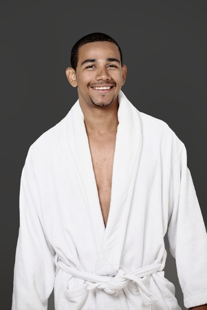 look latino: Smiling guy in luxurious bathrobe