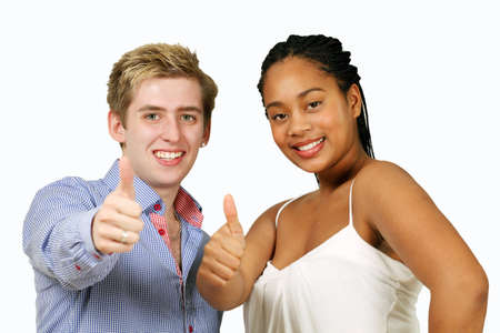Happy diverse couple showing thumbs up  photo