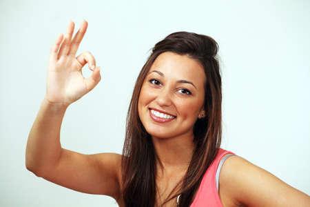 Happy girl making ok hand sign  photo