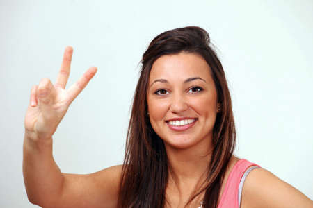 Peace sign by smiling female Stock Photo - 9613224