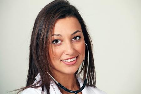 Pretty female doctor smiling face closeup Stock Photo - 9646102