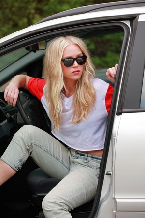 Young woman waiting impatiently in car Stock Photo - 9646104