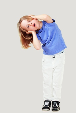 Small child covering ears maybe against noise photo