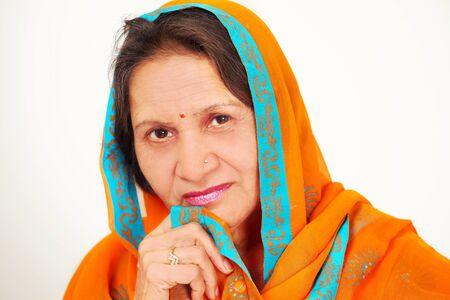 Beautiful mature indian woman face closeup in sari photo