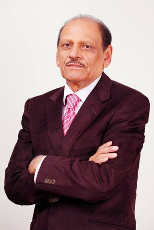 Handsome dynamic senior businessman photo