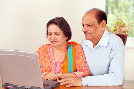 indian couple: Mature indian couple on home computer  Stock Photo