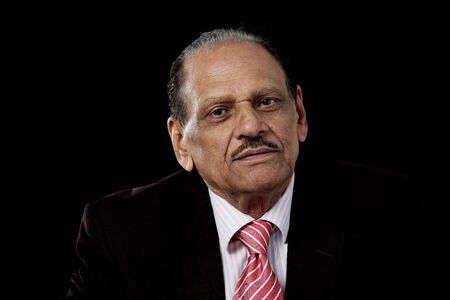Senior indian man in business suit on black background Stock Photo - 9862180