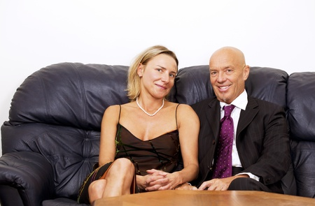 Business tycoon with young beautiful wife photo