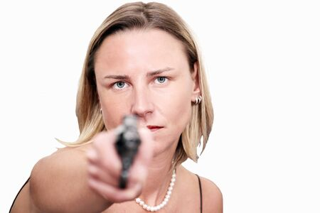 women with guns: Tough blonde woman raises gun