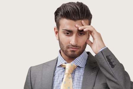 Worried businessman thinking about new challenges photo
