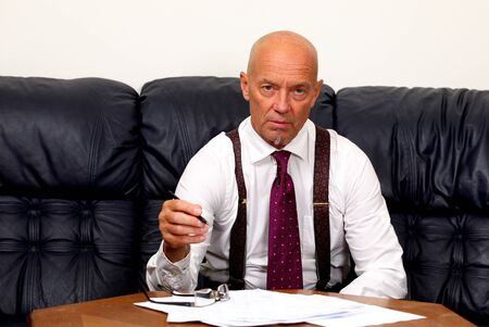 The boss at work signing documents photo