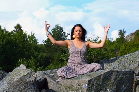 Female yoga in beautiful fresh nature at the mountains photo