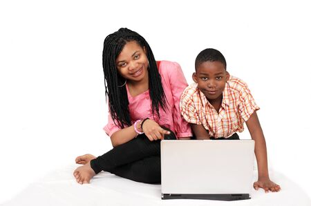 Two cute kids having fun on laptop Stock Photo - 10282540