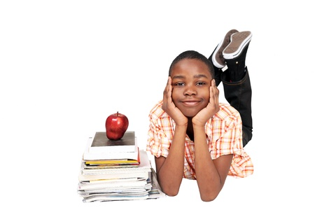 Schoolboy with books and apple Stock Photo - 10306040