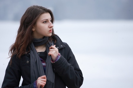 Young woman outdoor on snowy winter day photo