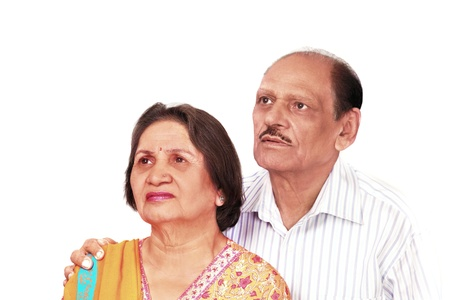 Senior indian couple looking up with worry expression photo