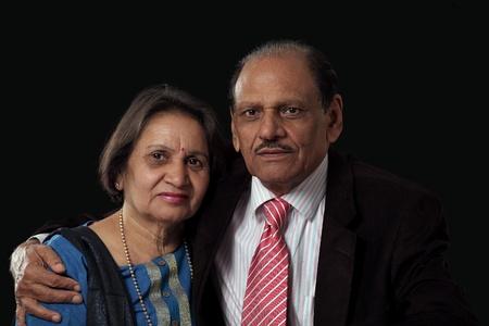 kameez: Mature indian couple on black background Stock Photo