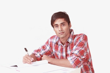Serious student writing notes Stock Photo - 10599860