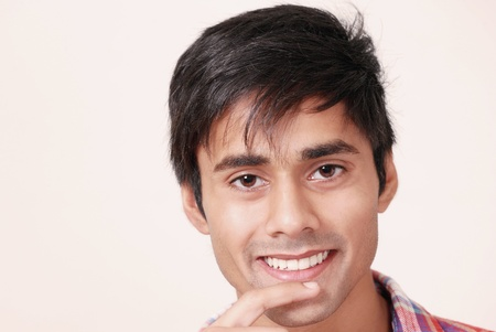 Cute guy grinning Stock Photo - 10599857