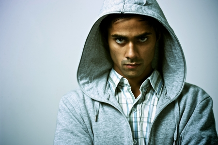 Guy in hood with tough expression Stock Photo - 10599864