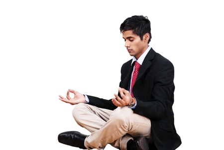 Young businessman in yoga lotus pose Stock Photo - 10633257