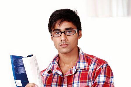 Serious guy reading photo