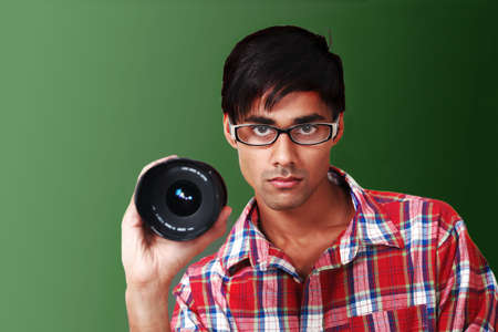 Photographer at work holding lens Stock Photo - 10633259