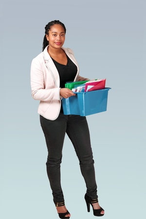 take action: Pretty hispanic office worker taking files in a box Stock Photo
