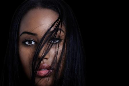Woman sensual expression with hair, a face closeup