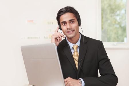 polite: Polite customer service agent listening on headset