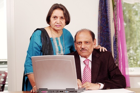 senior asian: Senior indian business couple in home office