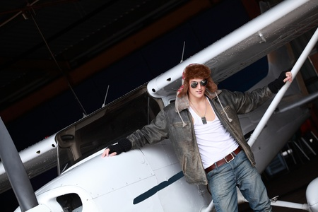 Young man with private airplane, a lifestyle image photo