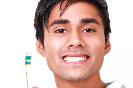 front teeth: Teeth care young man with toothbrush