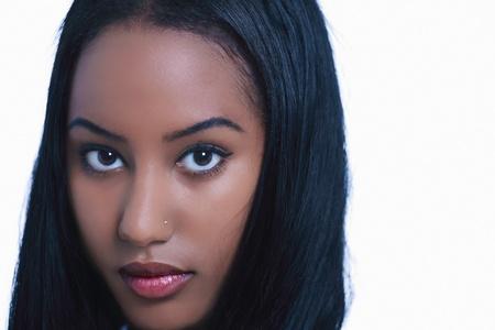 Beautiful ethnic woman face closeup Stock Photo