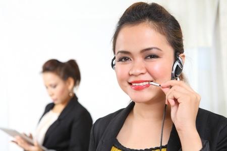 Pretty ethnic businesswoman on telephone headset Stock Photo - 10910560