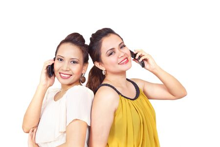 oral communication: Smiling filipino girls on mobile phones