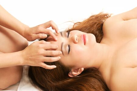 Pretty woman getting face and head massage Stock Photo - 10910572