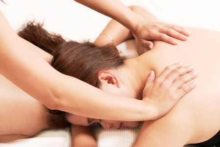 Young woman getting a relaxing body massage photo