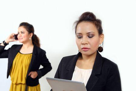 Asian businesswomen at work during travel transit photo