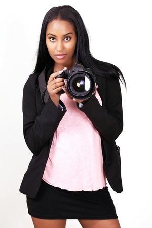 Cute female photographer in action Stock Photo - 11042963