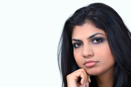 Pretty indian subcontinent girl looking intently  Stock Photo
