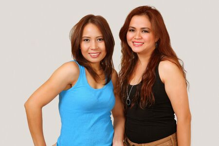 Two beautiful smiling asian girls photo