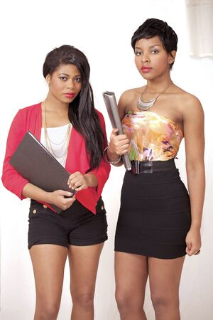 Two cute college girls in trendy fashion clothes Stock Photo - 11240199