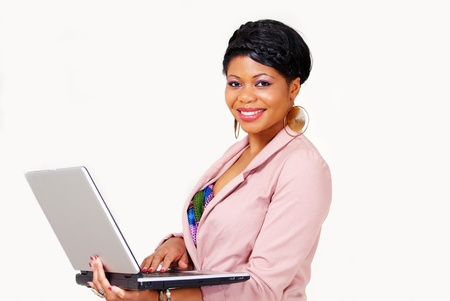 Cute ethnic lady standing with laptop smiling Stock Photo - 11240193