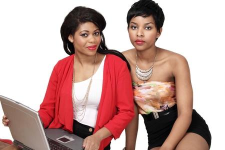 Pretty girls shopping online on laptop photo