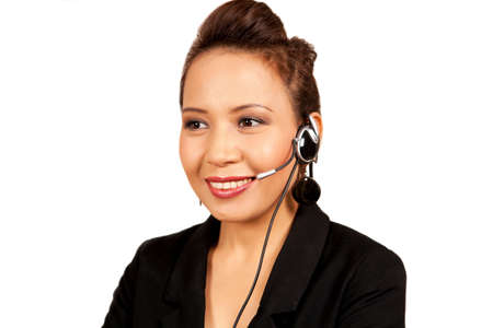 Polite pretty asian receptionist with headset Stock Photo - 11365242